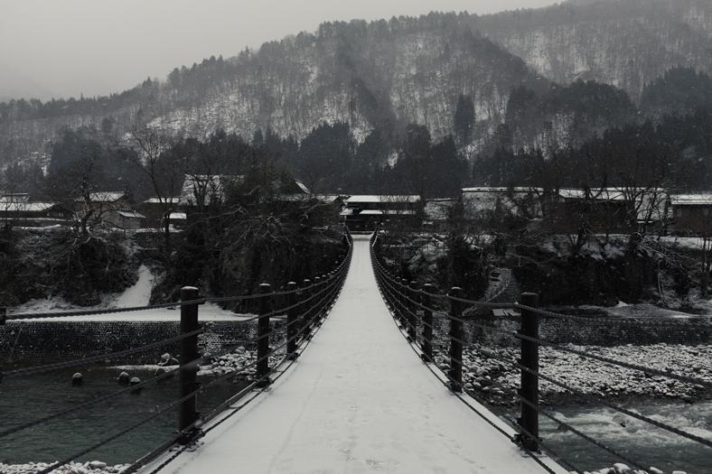 Shirakawago in Winter - Suspension Bridge   George Nobechi